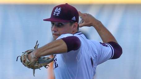 Mississippi State pitcher JT Ginn throws during the