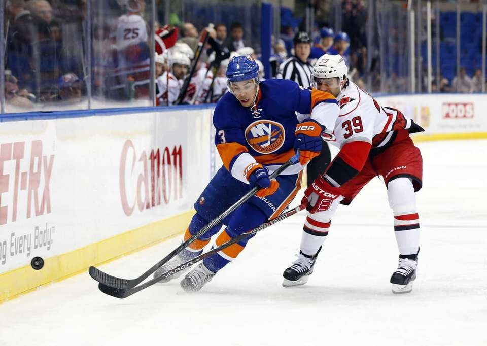 Travis Hamonic carries the puck up the ice