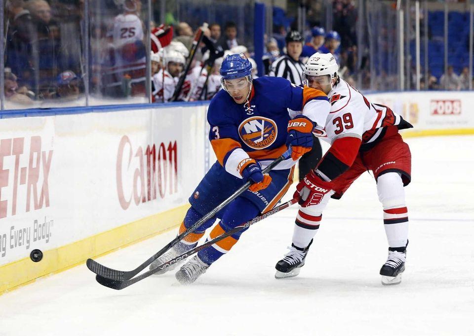 Travis Hamonic carries the puck up the ice