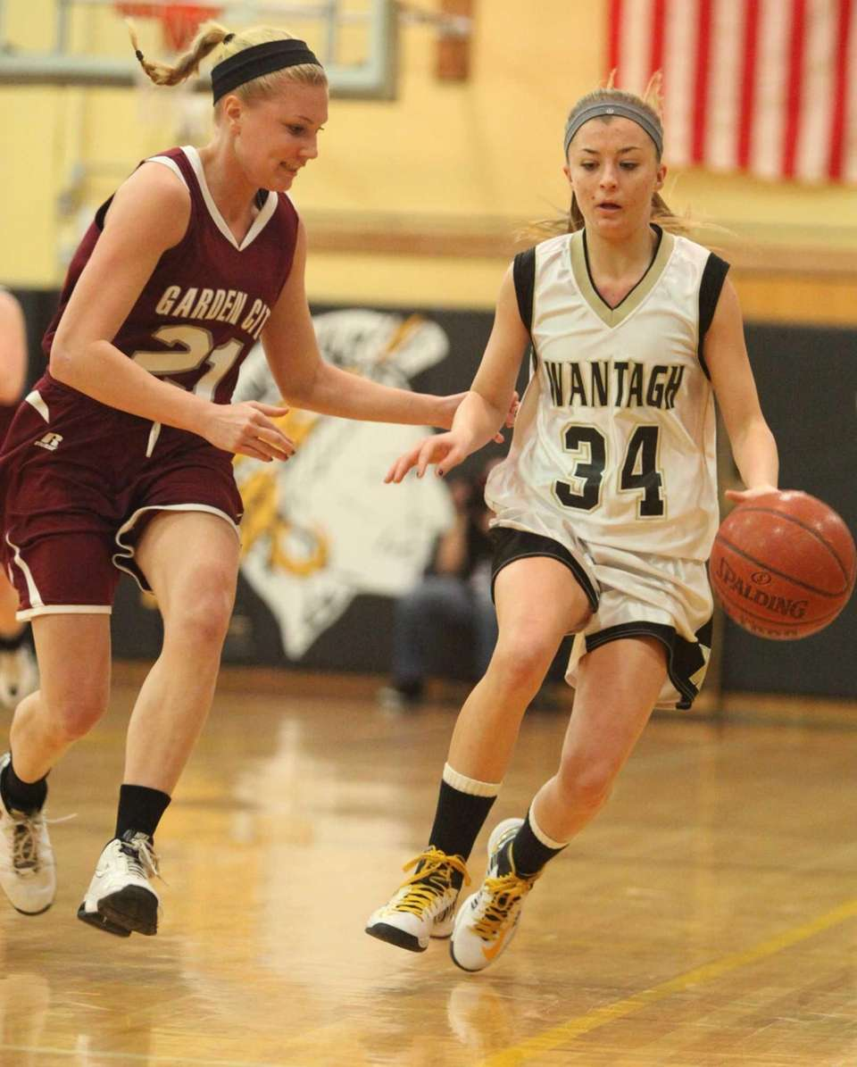 Wantagh's Nikki Sliwak is defended by Garden City's