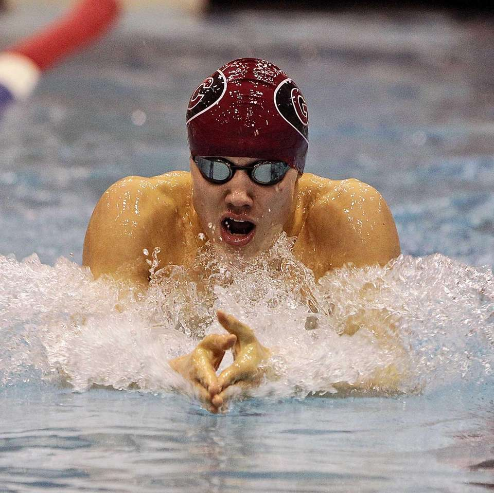 Garden City's Joseph Lozano swims the breaststroke leg