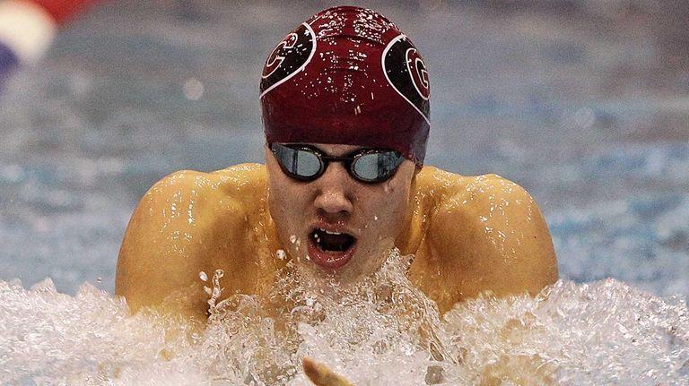 Garden City's Joseph Lozano swims the breaststroke leg