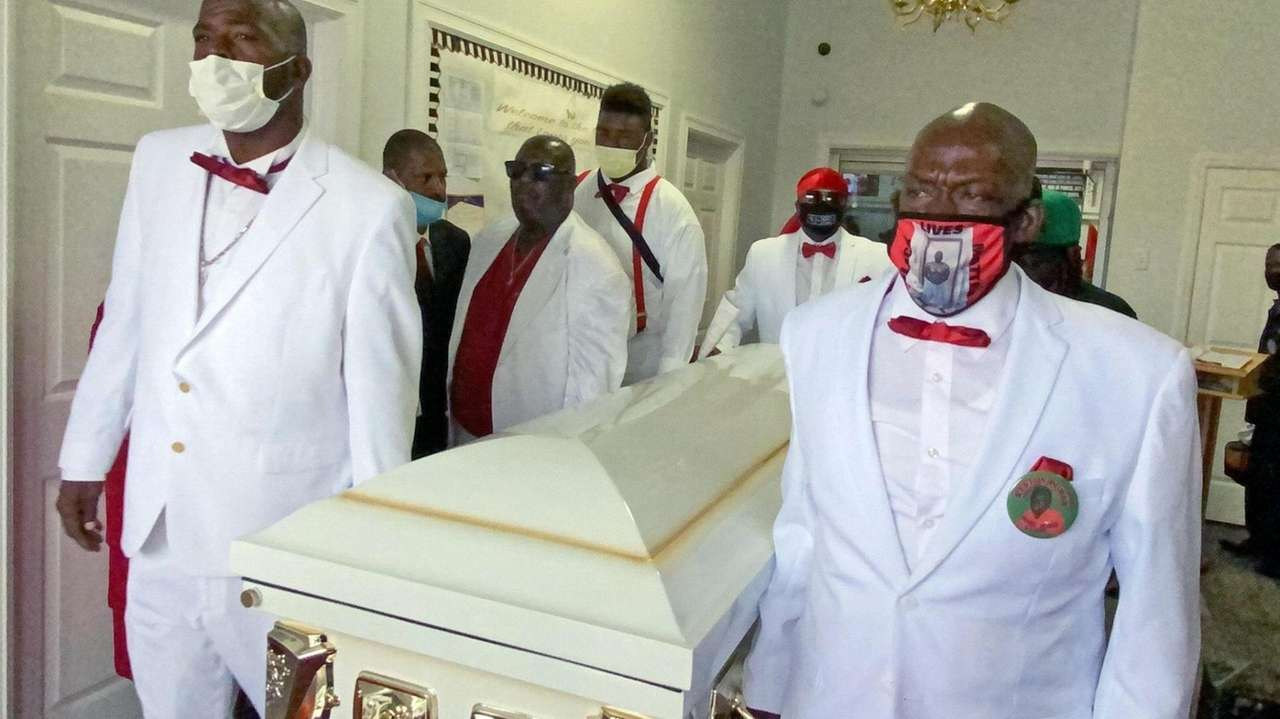 At his funeral, Floyd's family members saythey still