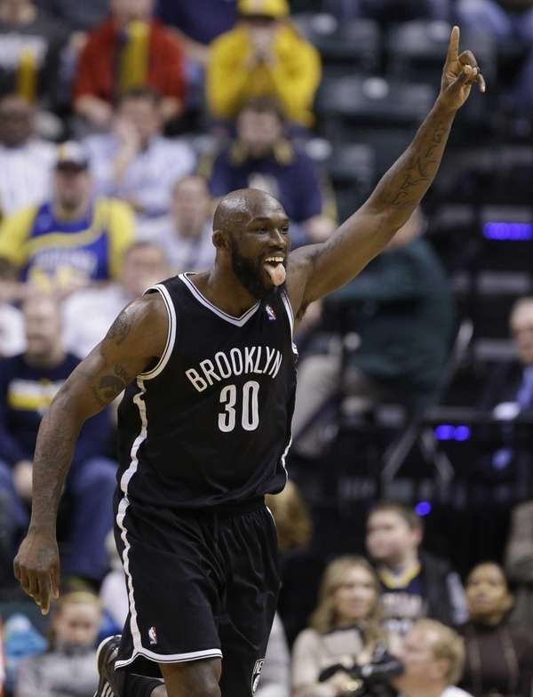 Reggie Evans celebrates a tip-in basket in the