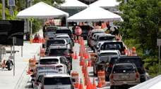 A drive-thru coronavirus testing site Friday in Miami
