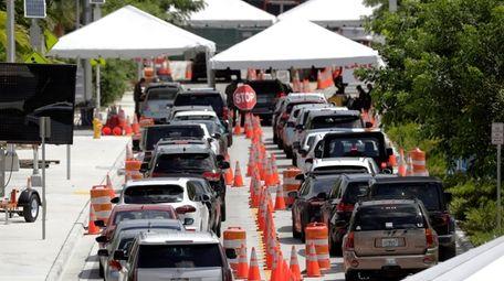 A drive-thru coronavirus testing site Friday in Miami
