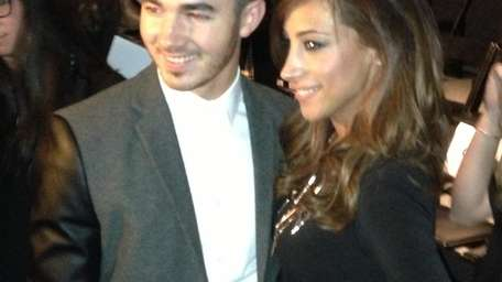 Kevin Jonas and wife Danielle pose on the