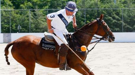 Polo player Rob Ceparano of Medford practices at