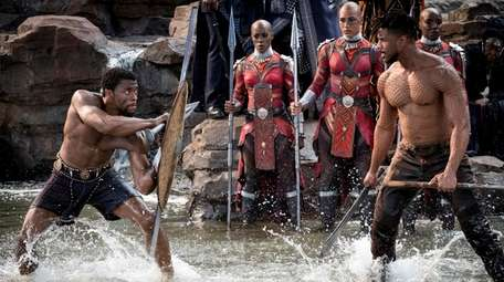 """Black Panther,"" staring Chadwick Boseman, left, and Michael"