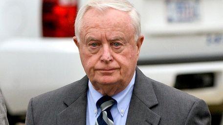Former Suffolk County District Attorney Thomas Spota walks
