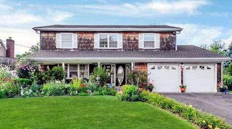 Priced at $625,000, this Colonial on Sandpiper Lane