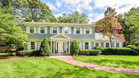 This five-bedroom Colonial on two acres in Lloyd