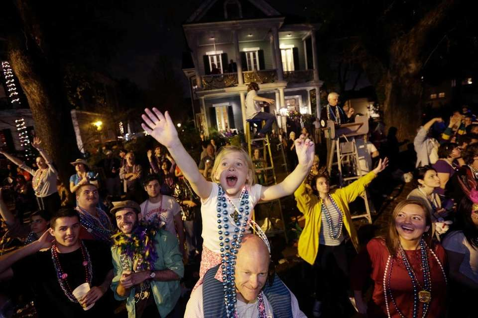 Addison Moran, 7, yells for beads and trinket