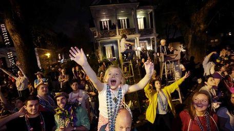 Addison Moran, 7, yells for beads and trinket