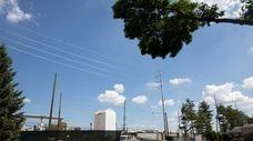 Utility poles at Merillon Ave and Nassau Blvd