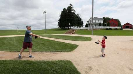 Jeremiah Bronson, of Ames, Iowa, plays catch with
