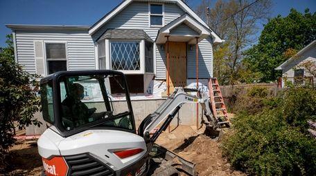 Contractor Ben Jackson, in an excavator, works on