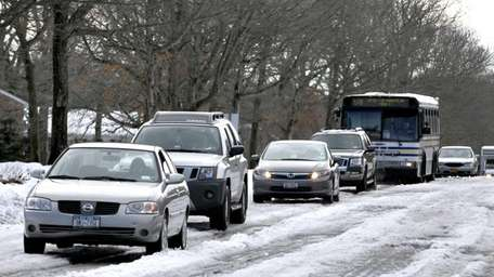 Cars move slowly north on College Road in