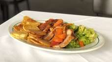 A lunch special of roast pork loin at