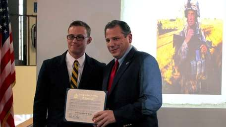 State Assemb. Andrew P. Raia, right, presents returning