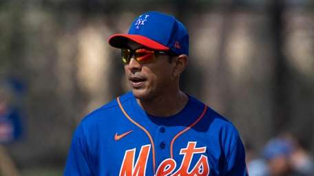 Mets manager Luis Rojas looks on during a