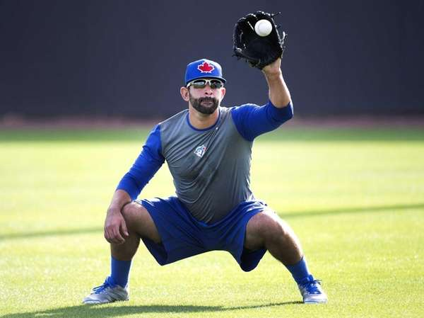 Toronto Blue Jays outfielder Jose Bautista catches a
