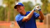Ruben Tejada takes a swing before batting practice