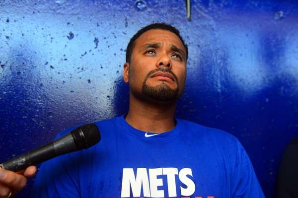 Johan Santana talks to the media during spring
