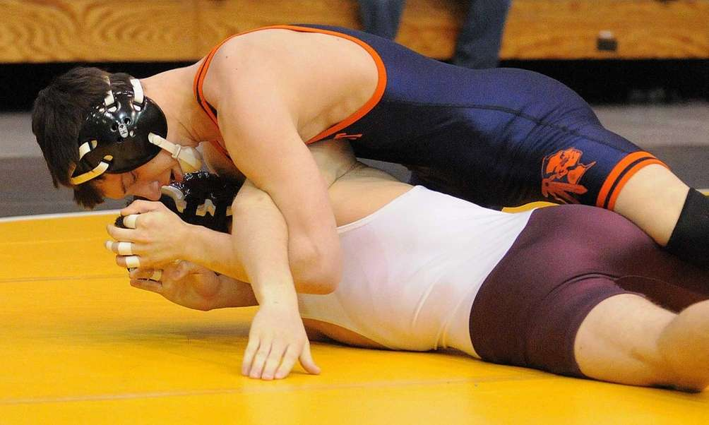 Mike Fera of Manhasset, top, battles Garden City's