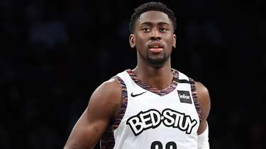 Brooklyn Nets guard Caris LeVert runs down court