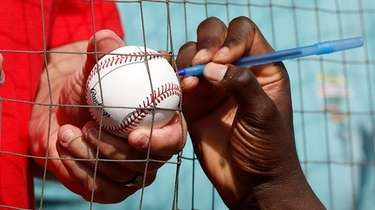 Pregame autographs during a spring training game on