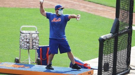 Mets bullpen catcher Eric Langill,  following the