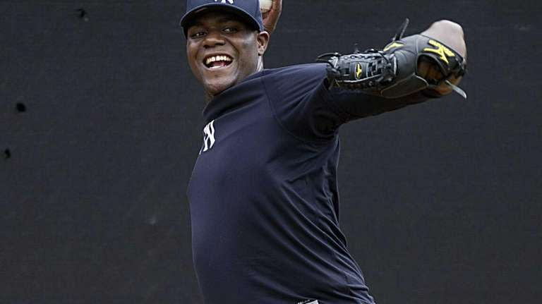 Michael Pineda delivers a pitch in the bullpen