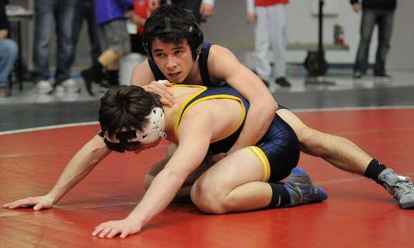 Steven Lee of West Babylon, top, battles James