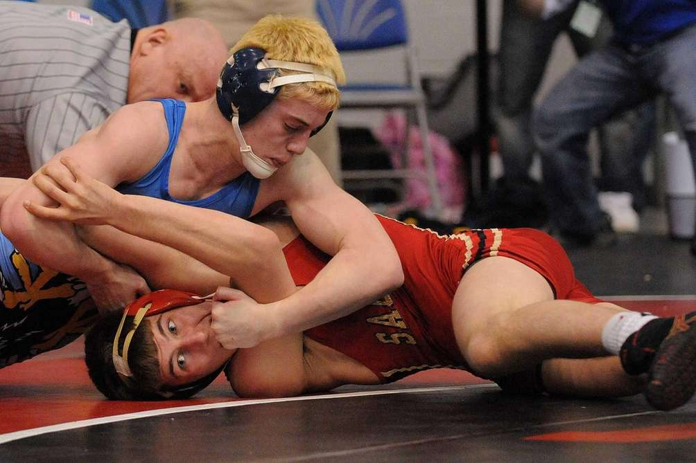 Chris Mauriello of Hauppauge, top, controls Conor O'Hara