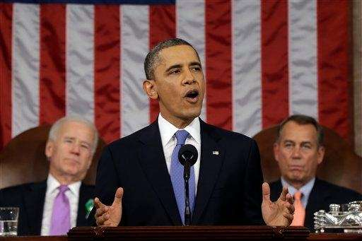 President Barack Obama, flanked by Vice President Joe