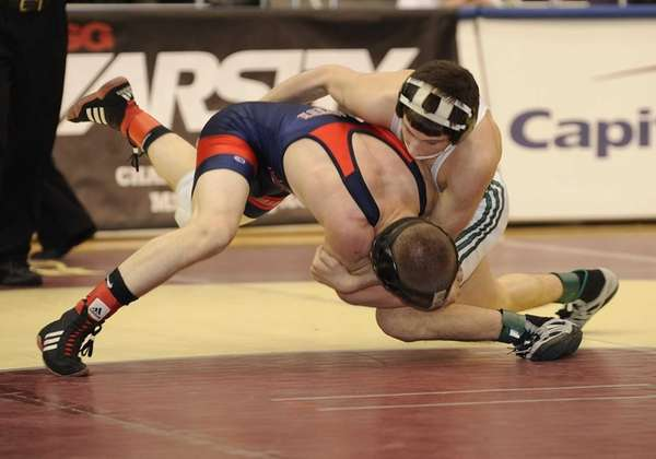 Bellmore JFK's Rob Person, top, wrestles MacArthur's Chris