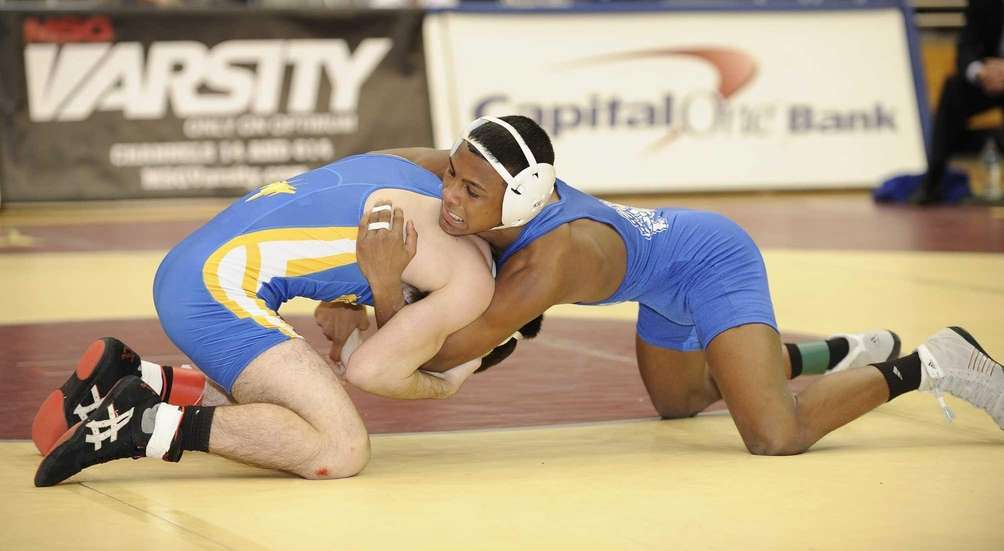 Long Beach's Steven Sewkumar wrestles East Meadow's Adam