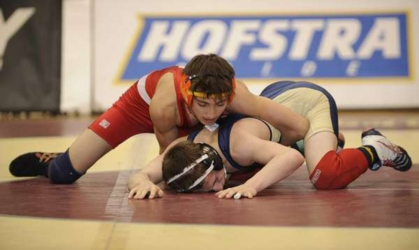 Syosset's Vito Arujau wins his match against Jericho's