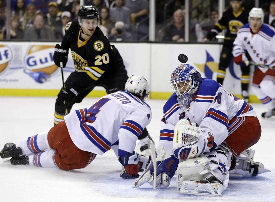 Rangers goalie Henrik Lundqvist (30) keeps the puck
