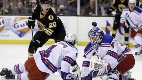 Rangers goalie Henrik Lundqvist (30) keeps the puck