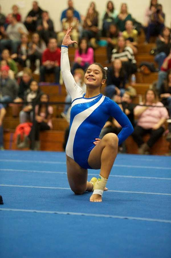 Plainview gymnast Jessica Lopez performs the floor routine.