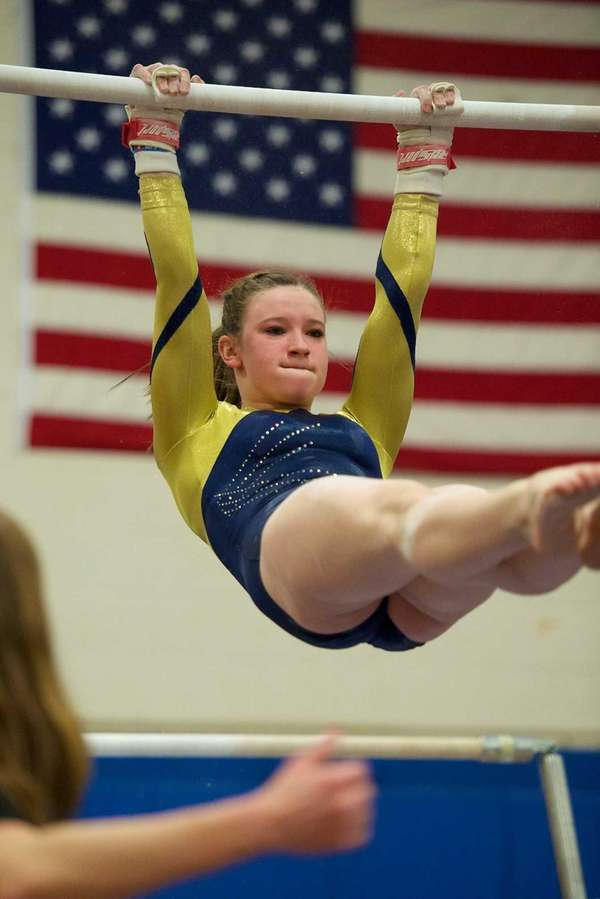Bethpage gymnast Lexi Fraher performs on the uneven