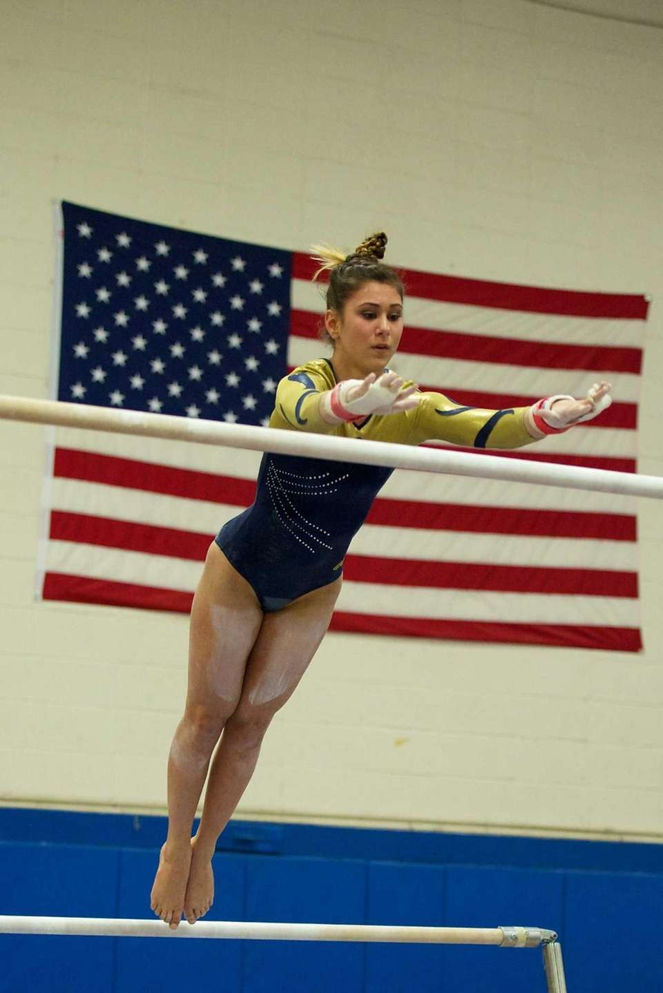 Bethpage gymnast Sarah Ciresi performs on the uneven