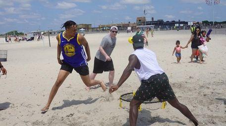 People play at Jones Beach on Saturday.