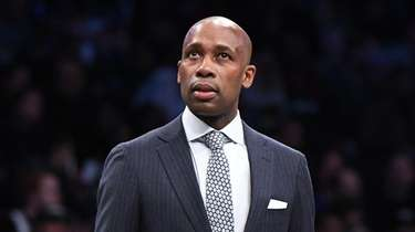 Nets interim head coach Jacque Vaughn looks on