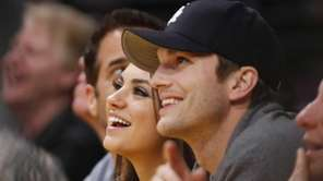 Actress Mila Kunis and actor Ashton Kutcher sit