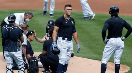 Aaron Judge #99 of the Yankees looks into