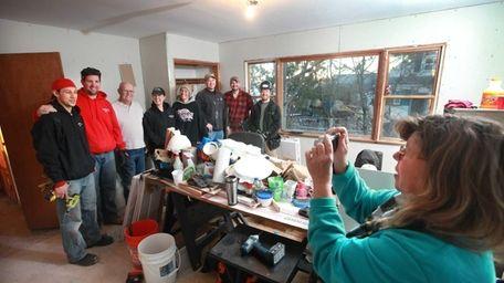 Rhonda Verrier takes a picture of the volunteers