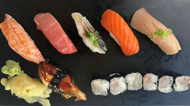 A plate of nigiri sushi on the new